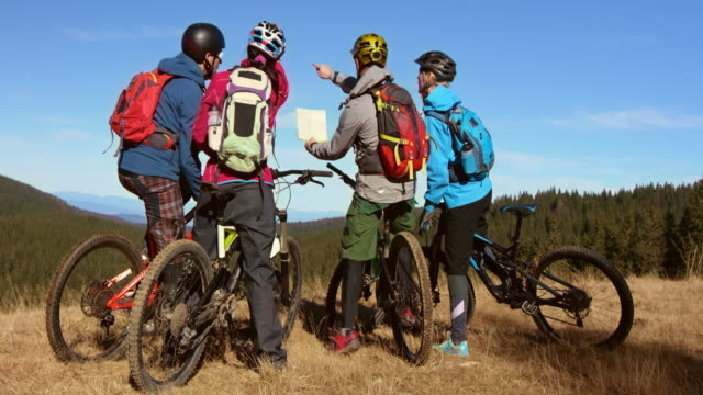 LD Group of bikers discussing the trail on map