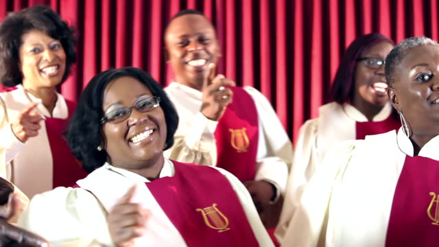 group of black men and women singing in church choir - church stock videos & royalty-free footage