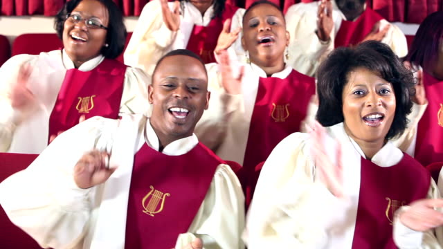 Group of black men and women singing in church choir