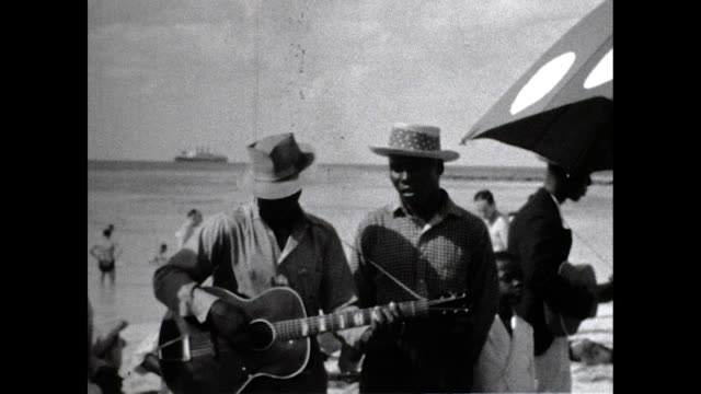 group of black men sing and play guitar on a beach in nassau, bahamas. - singing stock videos & royalty-free footage