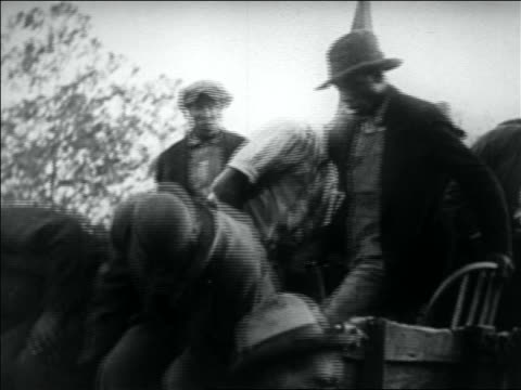 b/w 1932 group of black wwi veterans getting off back of truck / washington dc - 1932 stock-videos und b-roll-filmmaterial