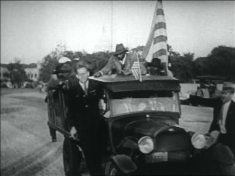 pan group of black wwi veterans riding on truck / washington dc - 1932 stock-videos und b-roll-filmmaterial