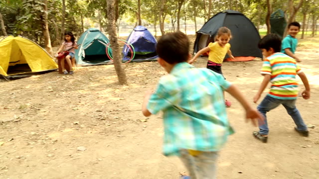 Group of boys and girls playing soccer in the park, Delhi, India