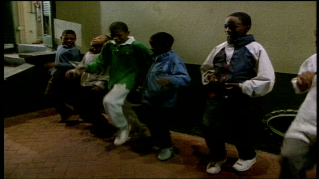 Group of Boys Dancing on New Orleans Sidewalk at Night