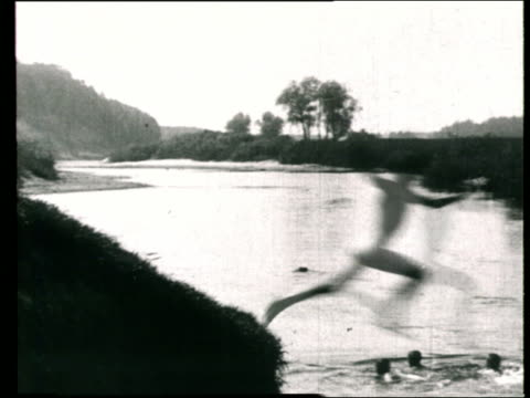 1925 MONTAGE B/W Group of boys jumping into river and swimming/ Russia