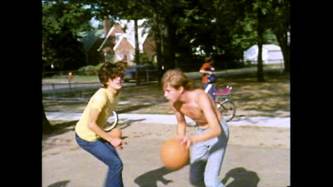 group of boys play basketball outdoors in detroit; 1972 - jeans stock videos & royalty-free footage