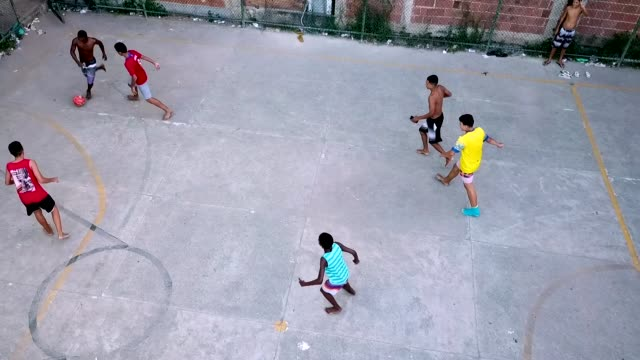 group of boys play soccer outside at piscinao de ramos community amidst the coronavirus pandemic on march 28, 2020 in rio de janeiro, brazil.... - sports activity stock videos & royalty-free footage