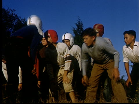 composite, group of boys (10-11) playing american football, 1950's, oklahoma, usa - the competition stock videos and b-roll footage