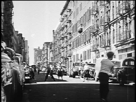 B/W 1950 group of boys playing stickball in New York City street
