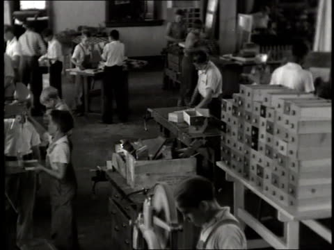 a group of boys work in a wood shop at boys town - nebraska stock-videos und b-roll-filmmaterial