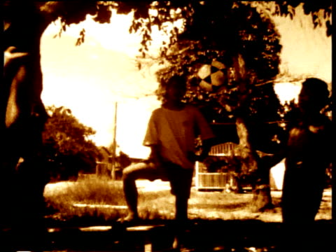 group of brazilian boys play with football sepia effect - sepia stock videos & royalty-free footage