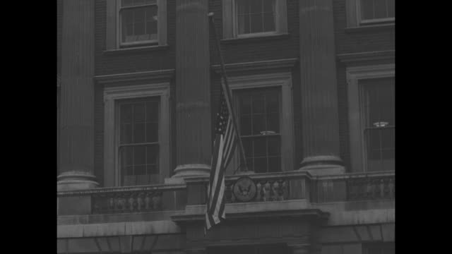 group of british men look upward / montage british flags at half mast over buildings / us flag at half mast on american embassy at macdonald house... - george vi of the united kingdom stock videos & royalty-free footage