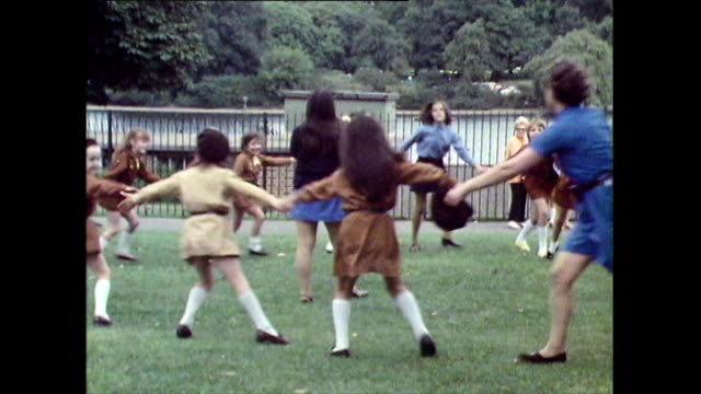 group of brownies hold hands and skip in a circle; 1971 - spinning stock videos & royalty-free footage