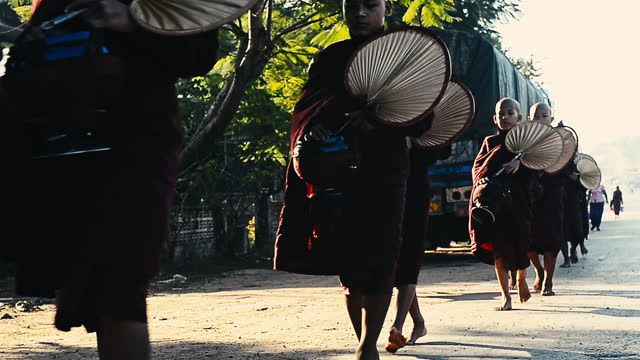 group of  buddhist monks to go about with a bowl to receive food at yangon - pagoda stock videos & royalty-free footage