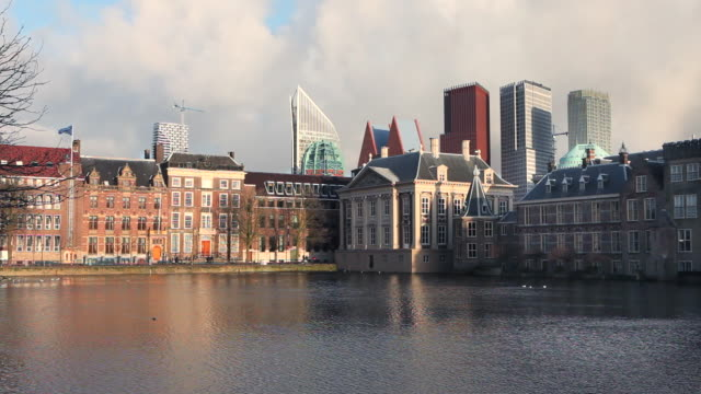 group of buildings called binnenhof, center of dutch politics. in the middle museum called mauritshuis, the hague, netherlands - binnenhof stock videos and b-roll footage