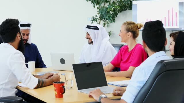 group of business executives listening to an arab businessman chairing a meeting - businesswear stock videos & royalty-free footage