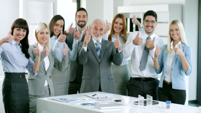 group of business people holding up their thumbs - thumbs up stock videos & royalty-free footage