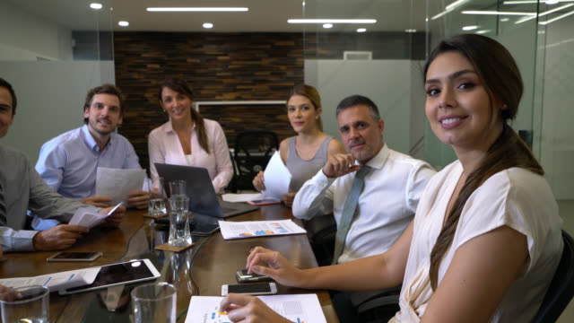 group of business people in a conference call talking to camera and then applauding all looking very happy - formal stock videos and b-roll footage