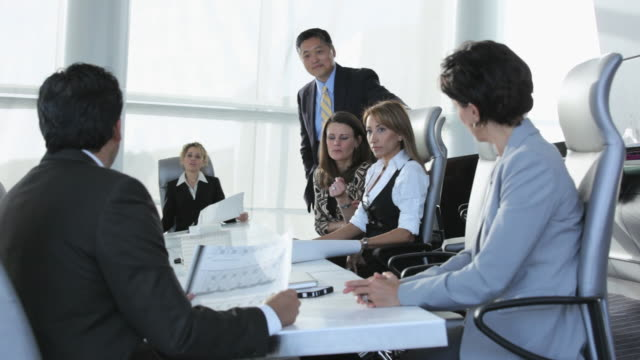 MS Group of Business People in Meeting, Looking at Plans, Shaking Hands in Agreement / Virginia Beach, Virginia, USA