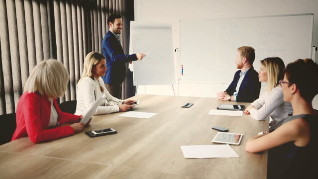 group of business people in office. - panel discussion stock videos & royalty-free footage
