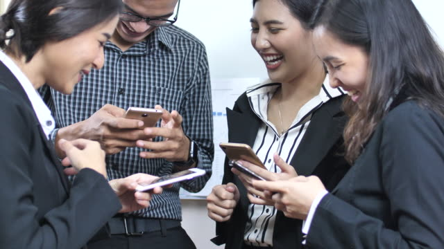 group of business people with smart phone phones - teenage couple stock videos & royalty-free footage