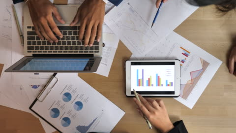 group of business people working with statistics - information medium stock videos & royalty-free footage