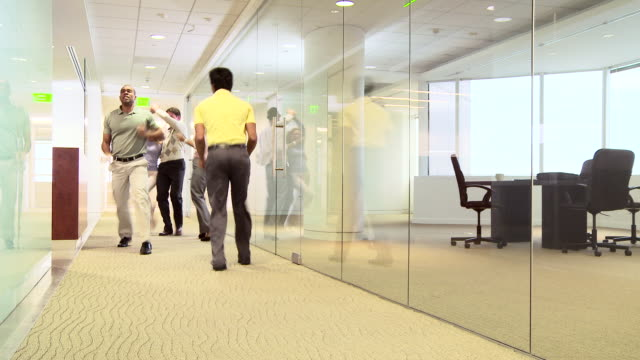 Group of business professionals dancing in office
