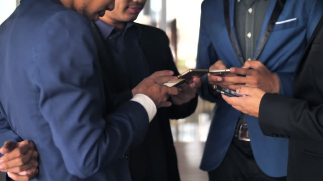 Group of business using phone
