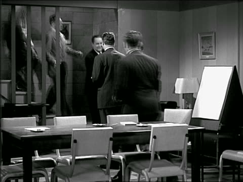 b/w 1949 group of businessmen coming downstairs into meeting room / shake hands + sit down - 1949 stock videos & royalty-free footage