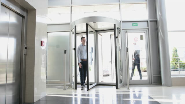 group of businessmen entering office building - lobby stock videos & royalty-free footage