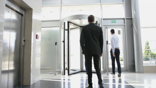 group of businessmen leaving office building - lobby stock videos & royalty-free footage