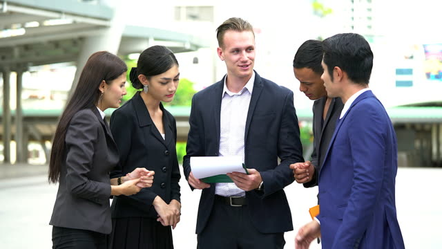 Group of businesspeople discussing during a walk.Business concept.