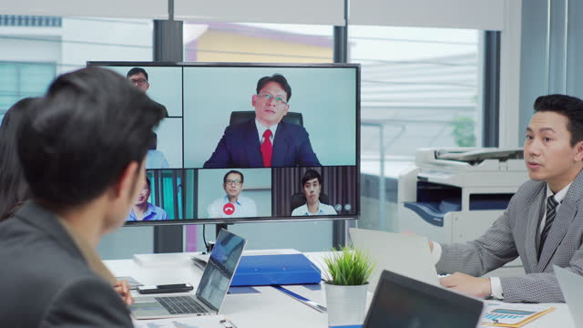 group of businesspeople having a meeting in the board room video call with a colleague. - female with group of males stock videos & royalty-free footage