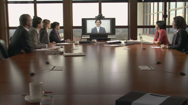 MS Group of businesspeople in conference room on video conference call/ Montclair, New Jersey
