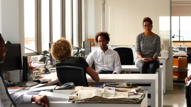 MS Group of businesspeople in discussion during all office meeting