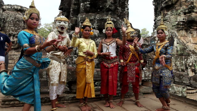 WS Group of Cambodian youths striking  poses in front of  Bayon Temple / Siem Reap, Siem Reap, Cambodia