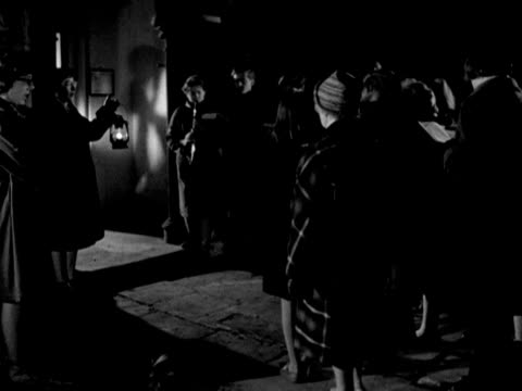 group of carol singers sing outside a building. 1965. - carol singer stock videos & royalty-free footage