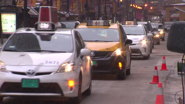 group of chicago cabbies turned off their meters and turned on their emergency flashers to protest the city of chicago's policies toward... - taxi stock videos & royalty-free footage