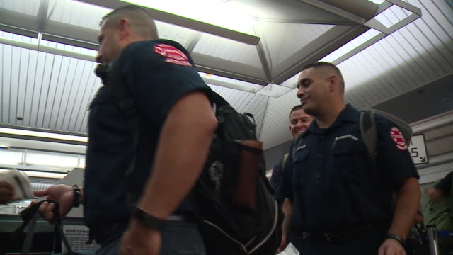 wgn a group of chicago firefighters 21 men and one woman left for puerto rico on morning of oct 4 to deliver emergency supplies and communications... - fire station stock videos & royalty-free footage