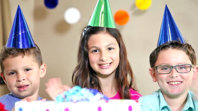 group of children at a birthday party waving - party hat stock videos and b-roll footage