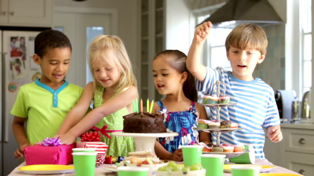 group of children celebrating birthday with cake and gifts - birthday candle stock videos & royalty-free footage