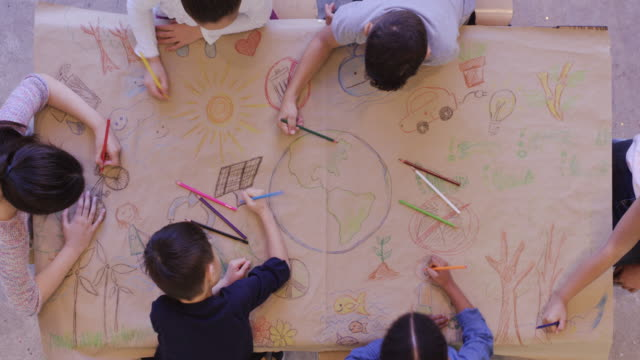group of children color environmentally conscious mural - evoluzione video stock e b–roll