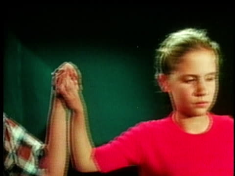 1961 ms group of children demonstrating electrical current by holding hands and touching battery / united states / audio   - menschenreihe stock-videos und b-roll-filmmaterial