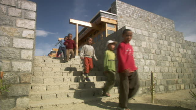 MS, Group of children descending school steps, Ladakh, Jammu and Kashmir, India