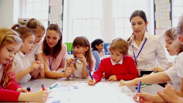group of children drawing in class - primary age child stock videos and b-roll footage