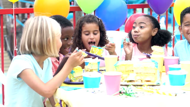 group of children eating cake at birthday party - compleanno video stock e b–roll