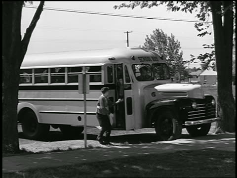 b/w 1946 group of children exiting school bus / industrial - primary school child stock videos & royalty-free footage