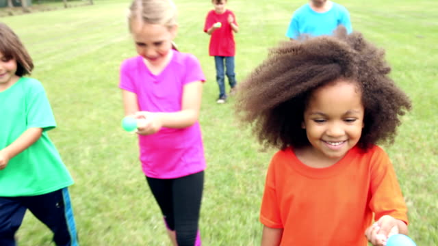 group of children having egg spoon race - spoon stock videos & royalty-free footage