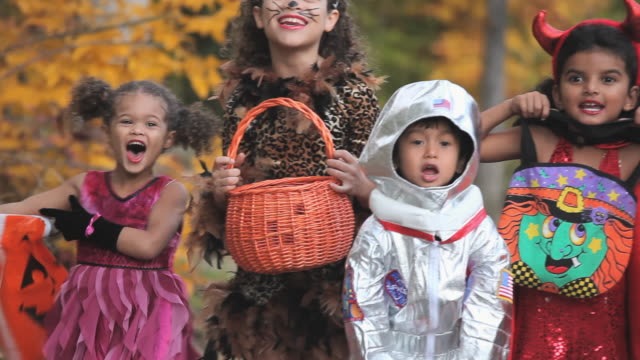 ms pan group of children (2-7) in halloween costumes asking for candy / richmond, virginia, usa. - halloween stock videos & royalty-free footage