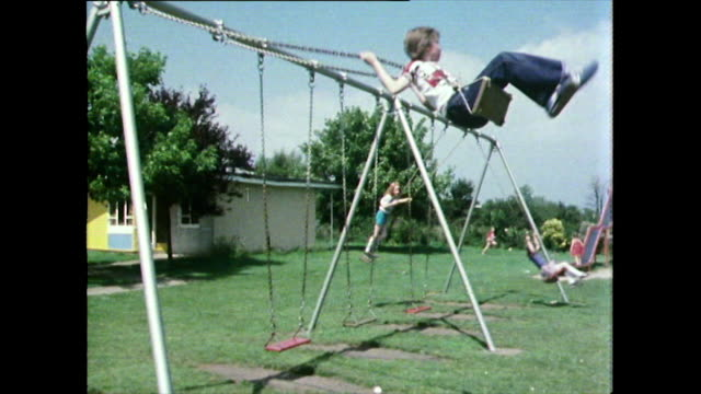 group of children in playground at uk holiday resort; 1981 - messing about stock videos & royalty-free footage